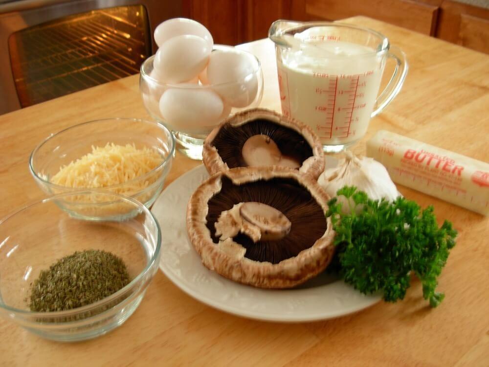 Ingredients Stuffed Portobello Mushrooms: Italian seasoning, parmesan cheese, eggs, heavy cream, portobello mushroom caps, garlic, parsley, and butter.