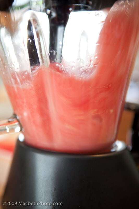 Blending the watermelon to create watermelon juice.