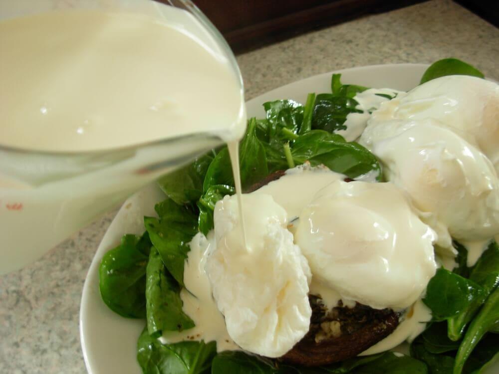 Pouring cream over eggs.