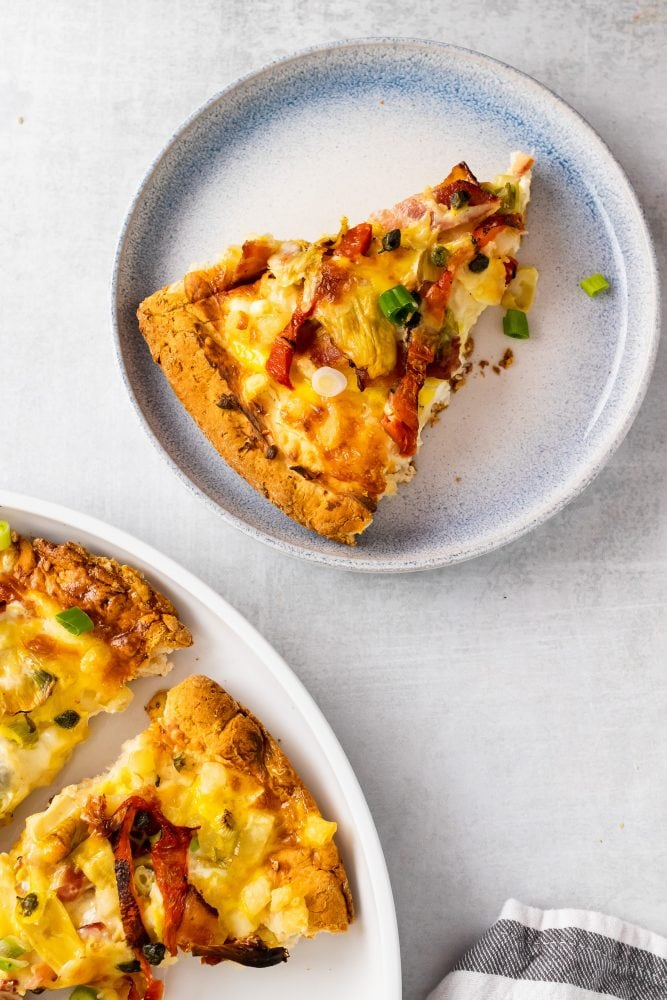 Overhead shot of single slice of breakfast pizza.