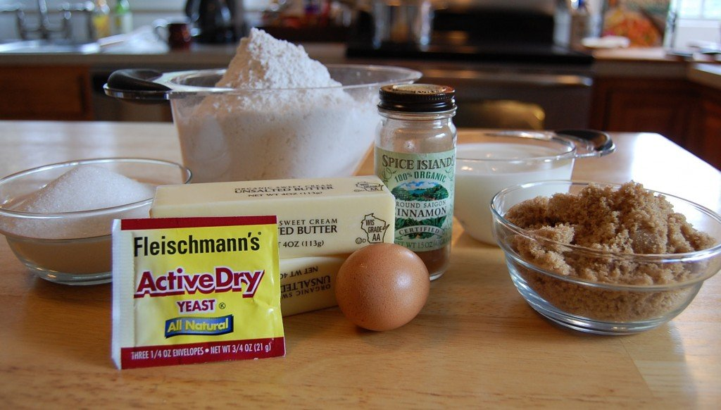 Cinnamon Roll Ingredients: sugar, flour, butter, yeast, egg, cinnamon, brown sugar, and milk.