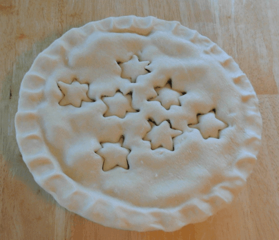 A photo of the tourtiere (meat pie) completely assembled, but not yet baked.
