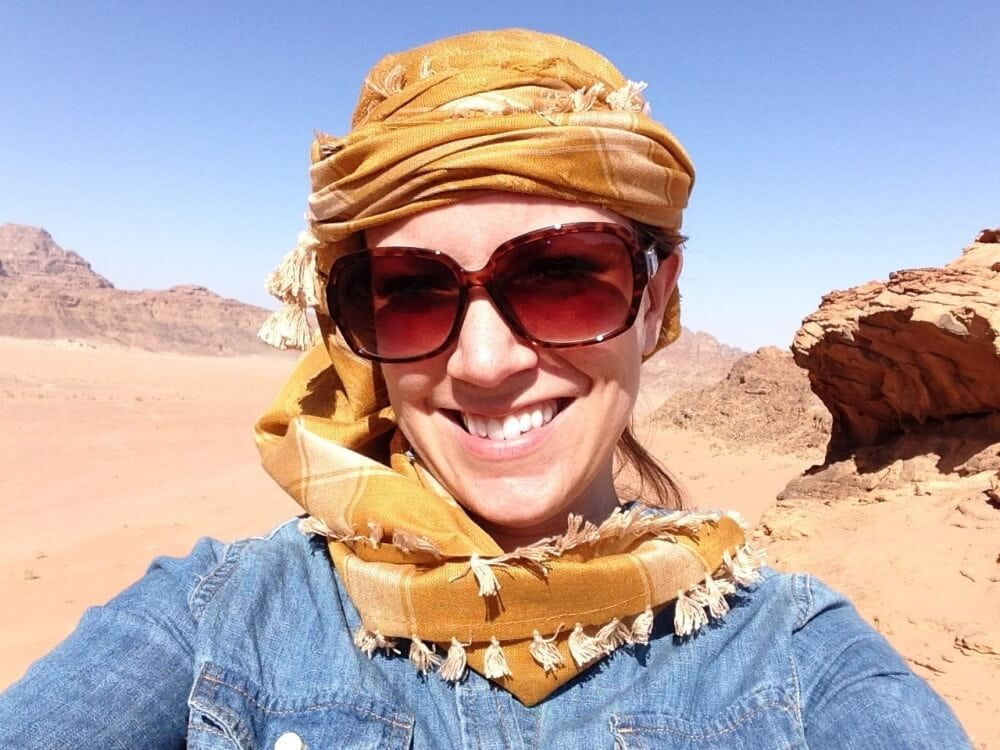 Rachelle wearing a head scarf and big sunglasses to help with sun and sand in the desert.