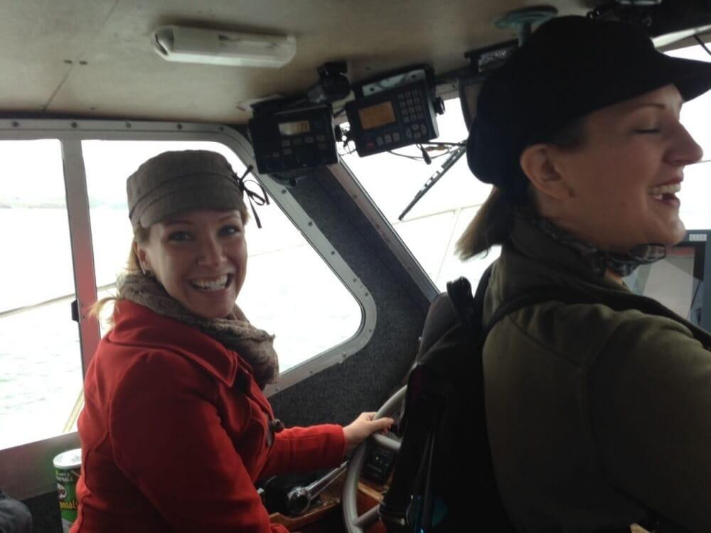 Rachelle Driving the boat around Hook Peninsula.