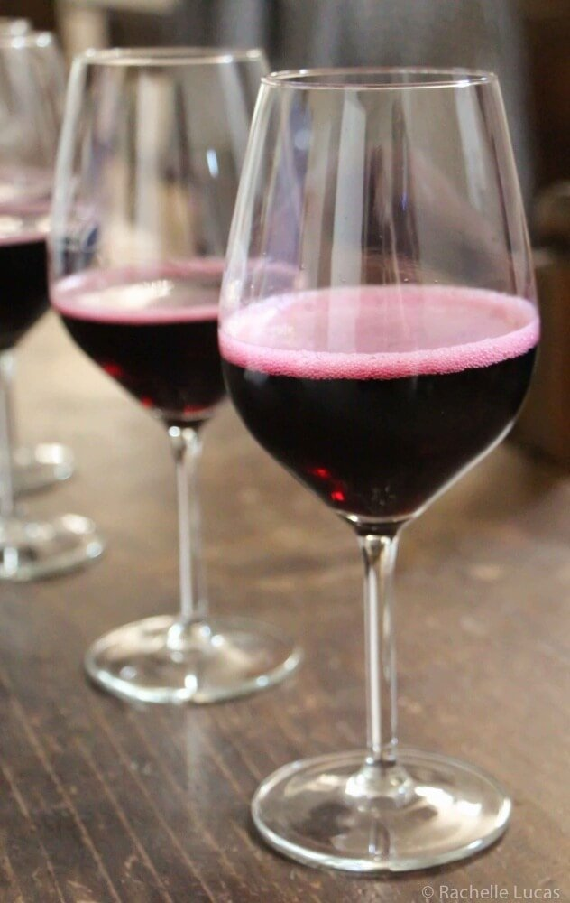 A glass of Lambrusco, an effervescent red wine from north of Bologna.