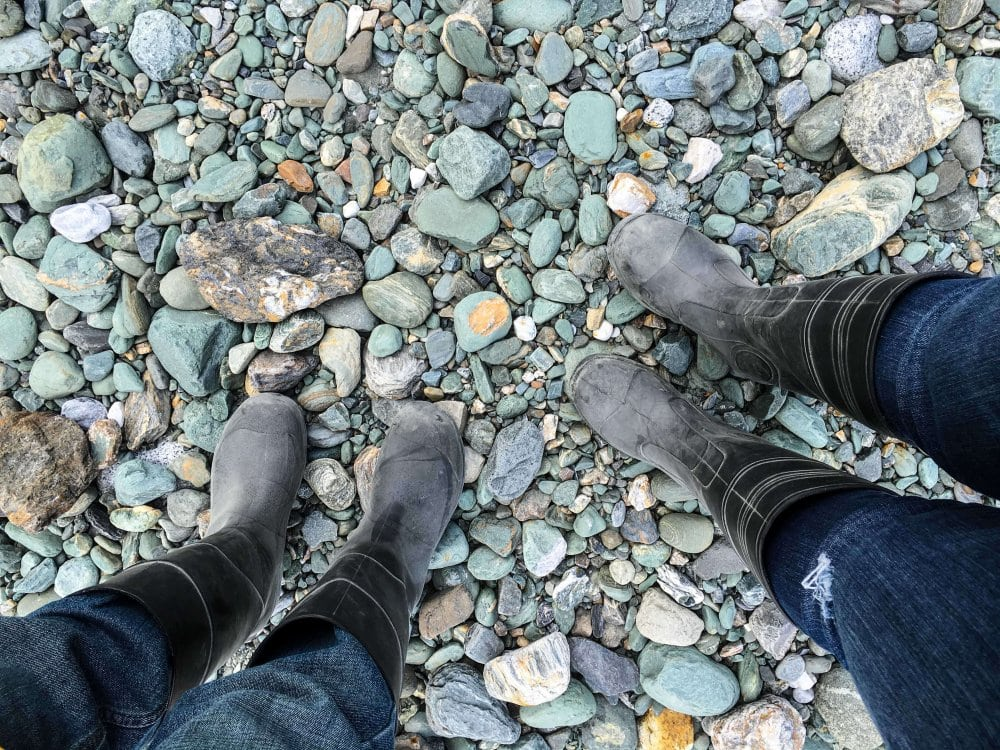 Knee high rubber boots worn for visiting glacier.