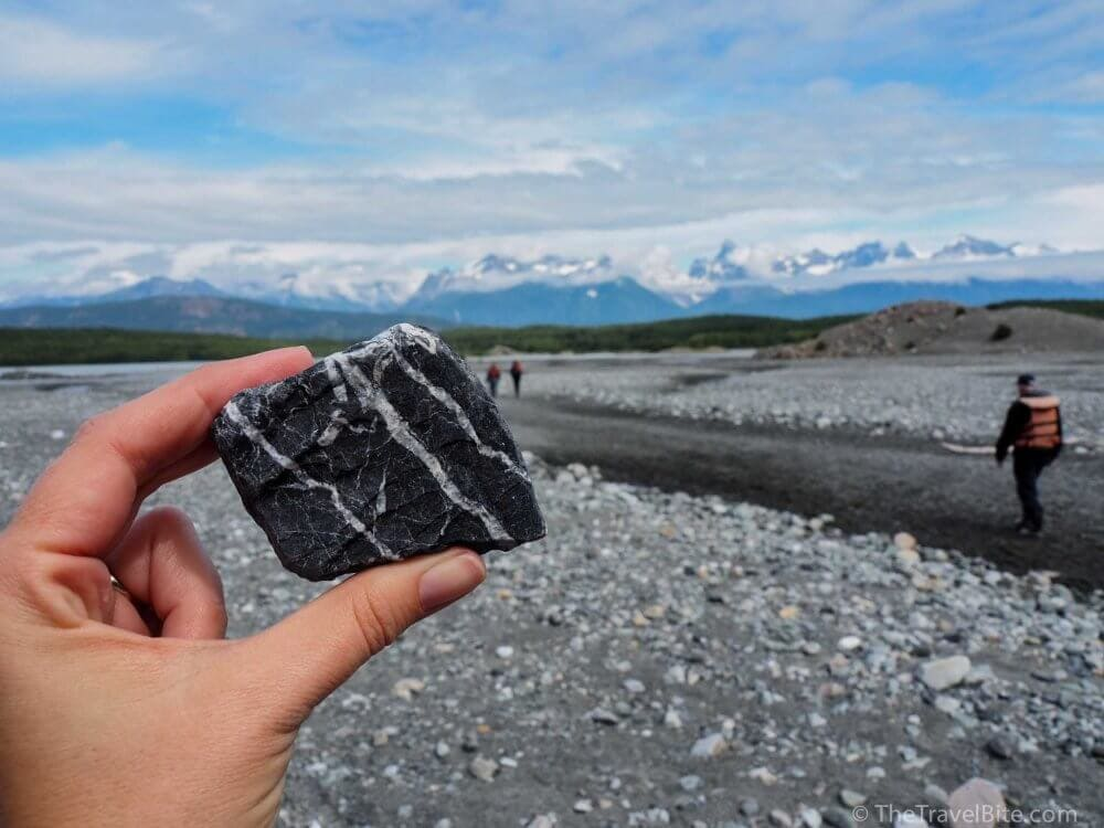 A black and white striped rock at the mouth of the glacier.