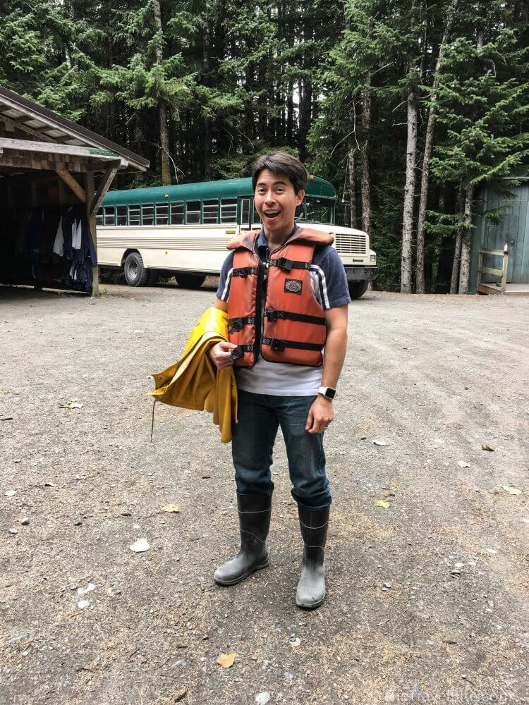 Pete smiling while wearing life jacket and boots.