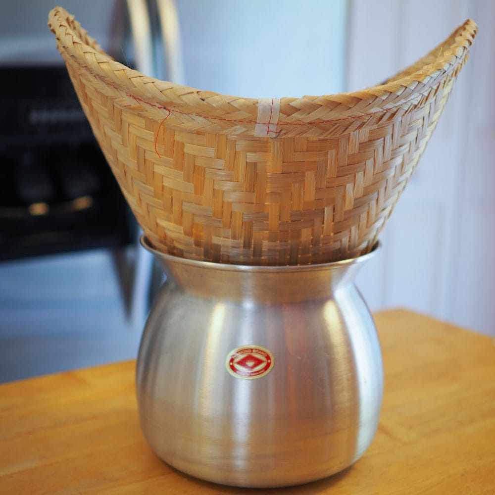 Traditional sticky rice bamboo steamer basket and pot.