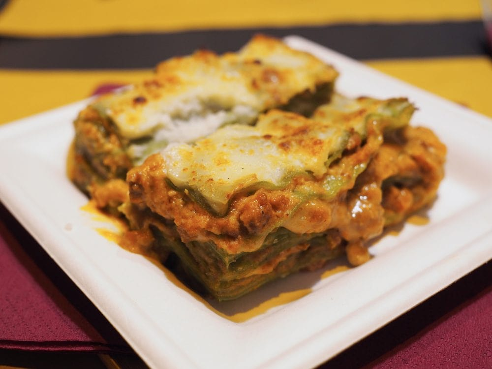 Bolognese Lasagna layered with cheese and green spinach noodles.