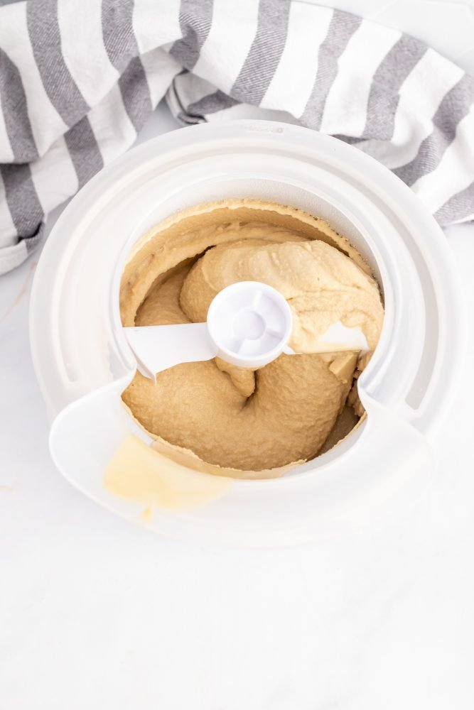 Overhead shot showing the ice cream maker paddle in the gelato with a thicker, soft serve texture.