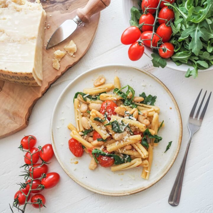 Strozzapreti with Roasted Tomatoes, Arugula, and Cannellini Beans