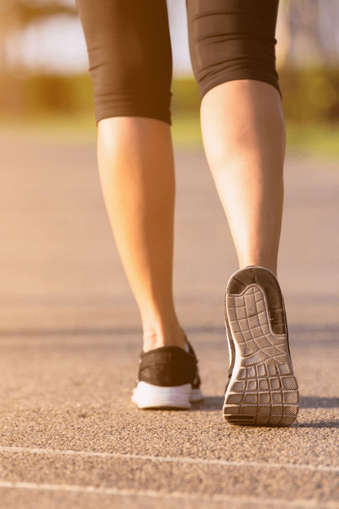Photo of woman's athletic shoes as she's about to walk.
