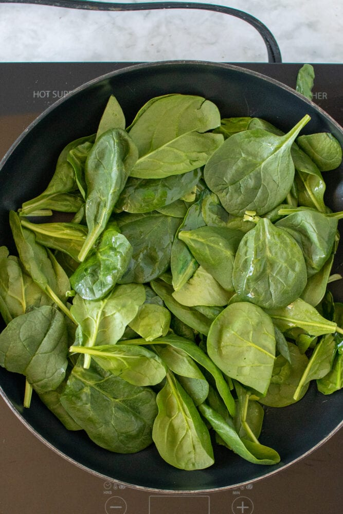 Overhead shot of cooking spinach.