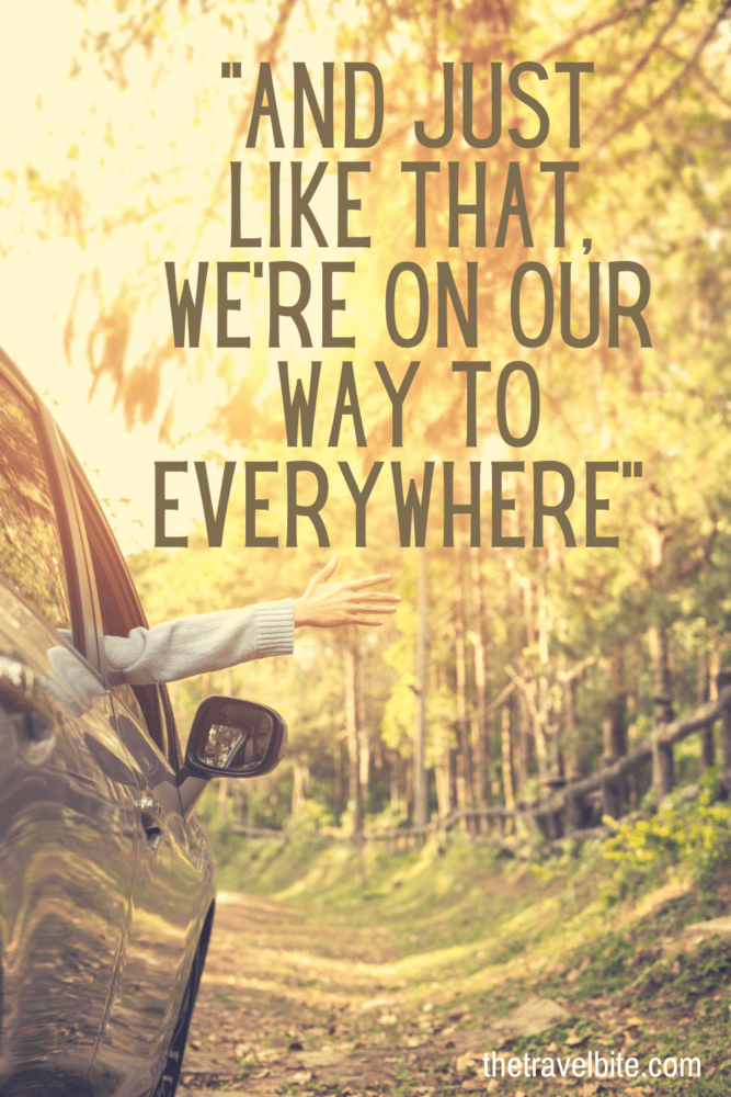 """Road Trip Quotes Pin - Driving Through A Forrest with quote """"Just like that, we're on our way to everywhere."""" - TheTravelBite.com"""