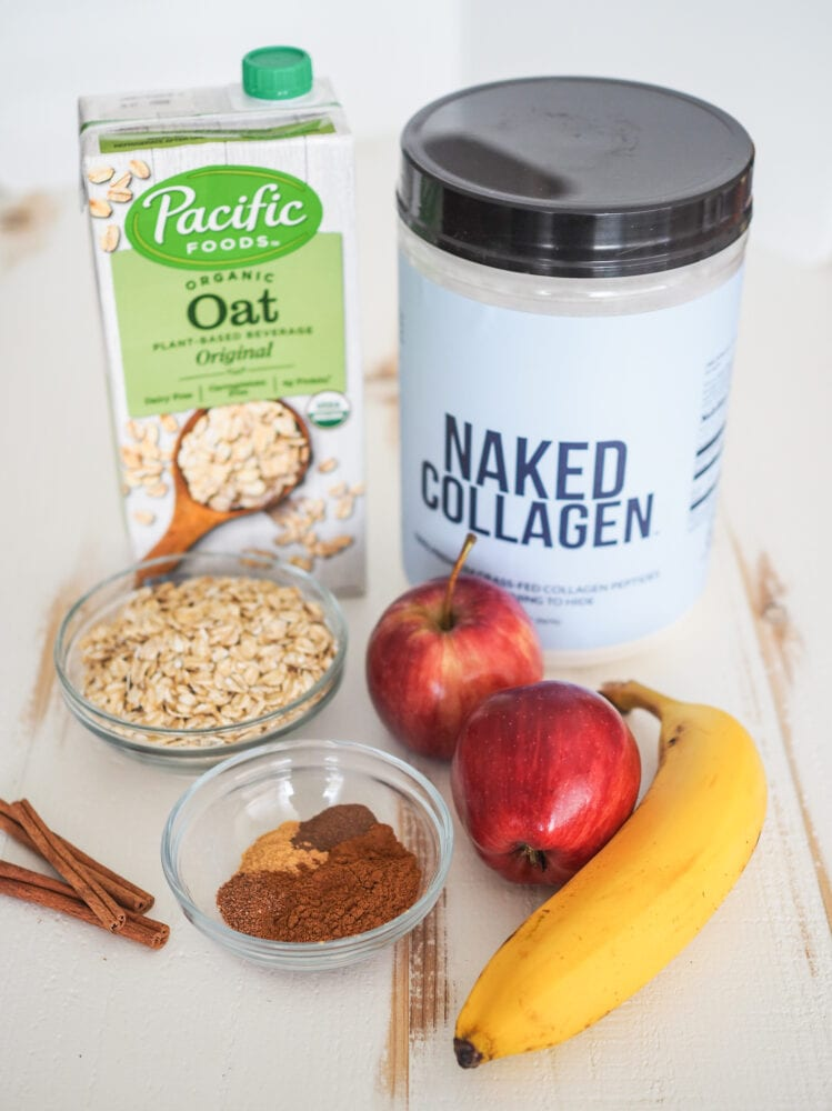 Photo of ingrediets for apple smoothie including oat milk, collagen powder, oatmeal, apples, banana, and spices.