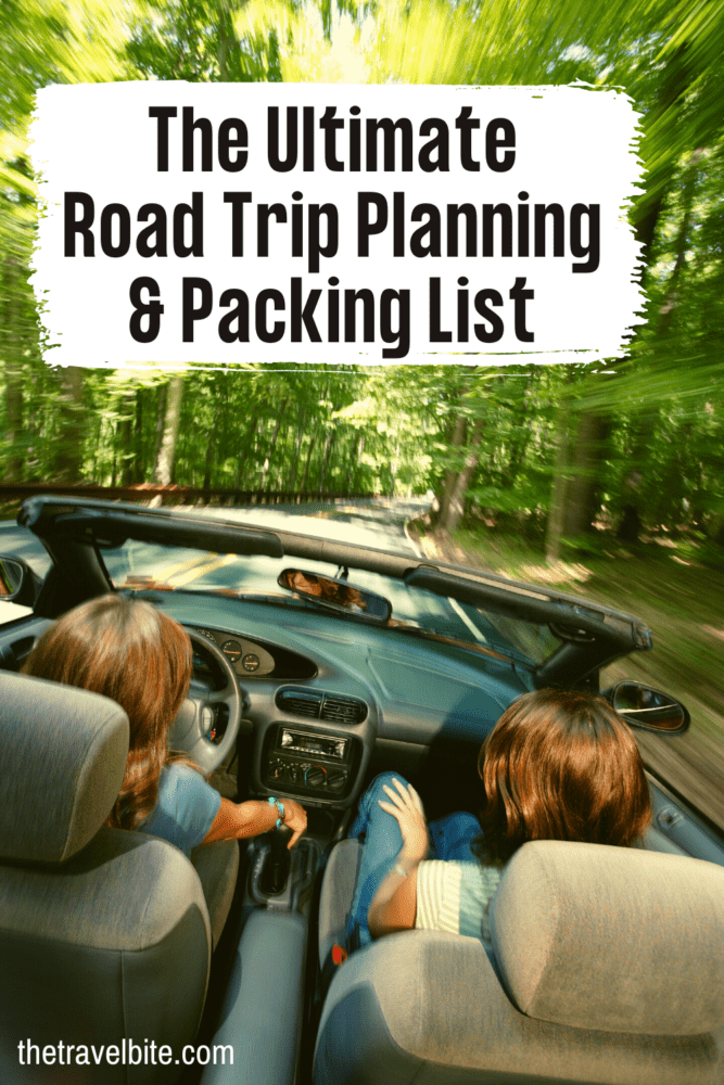 Road Trip Essentials Image to pin for Pinterest. Couple in convertible driving in a forest.
