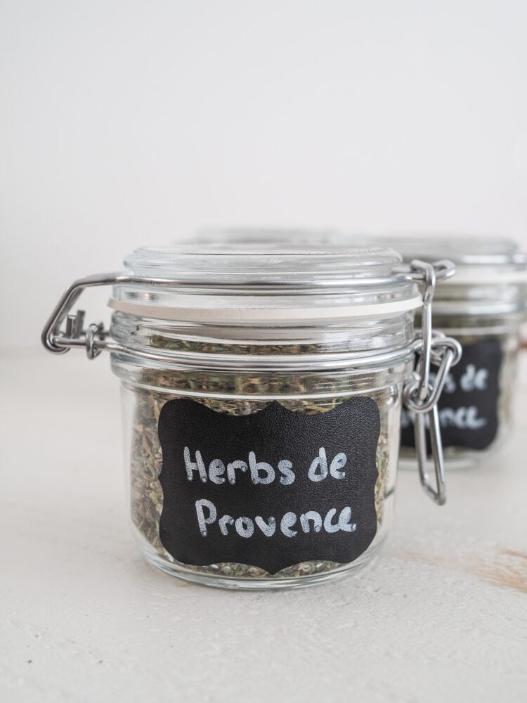 Glass jar sealed with clamp lid and labeled with Herbs de Provence.