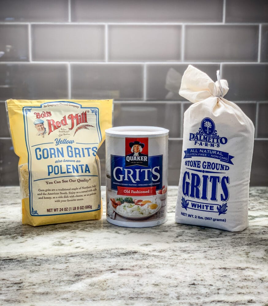 Three different styles of cornmeal including yellow corn grits by Bob's Red Mill, Quaker old fashioned grits, and Palmetto Farms stone ground grits.