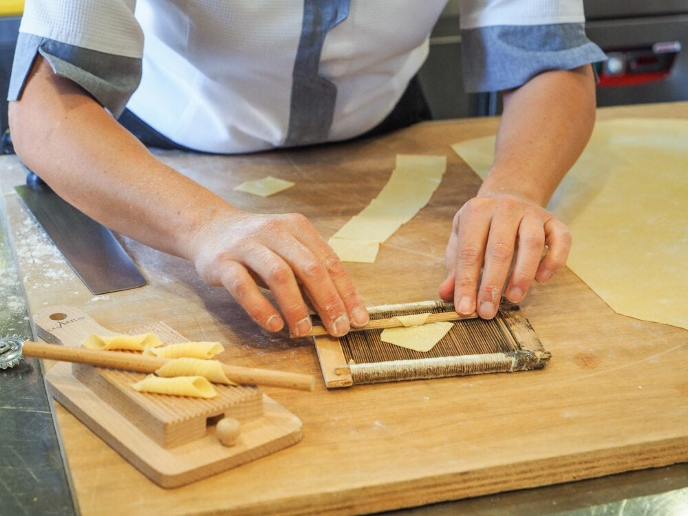Rolling out different shapes of pasta.