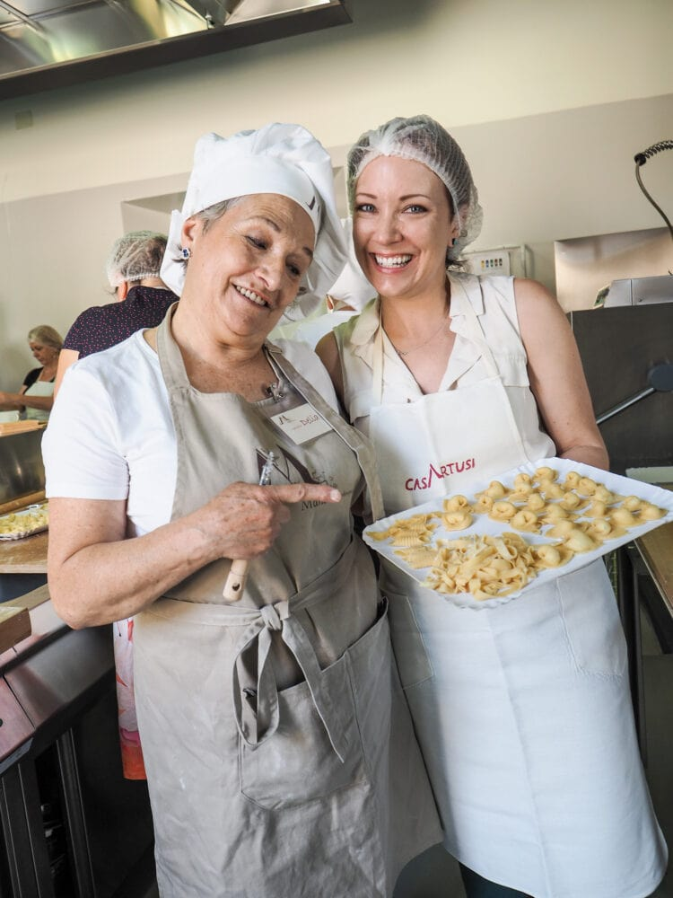 Rachelle with her instructor, Delia, holding finished pasta she made at the Casa Artusi Cooking School