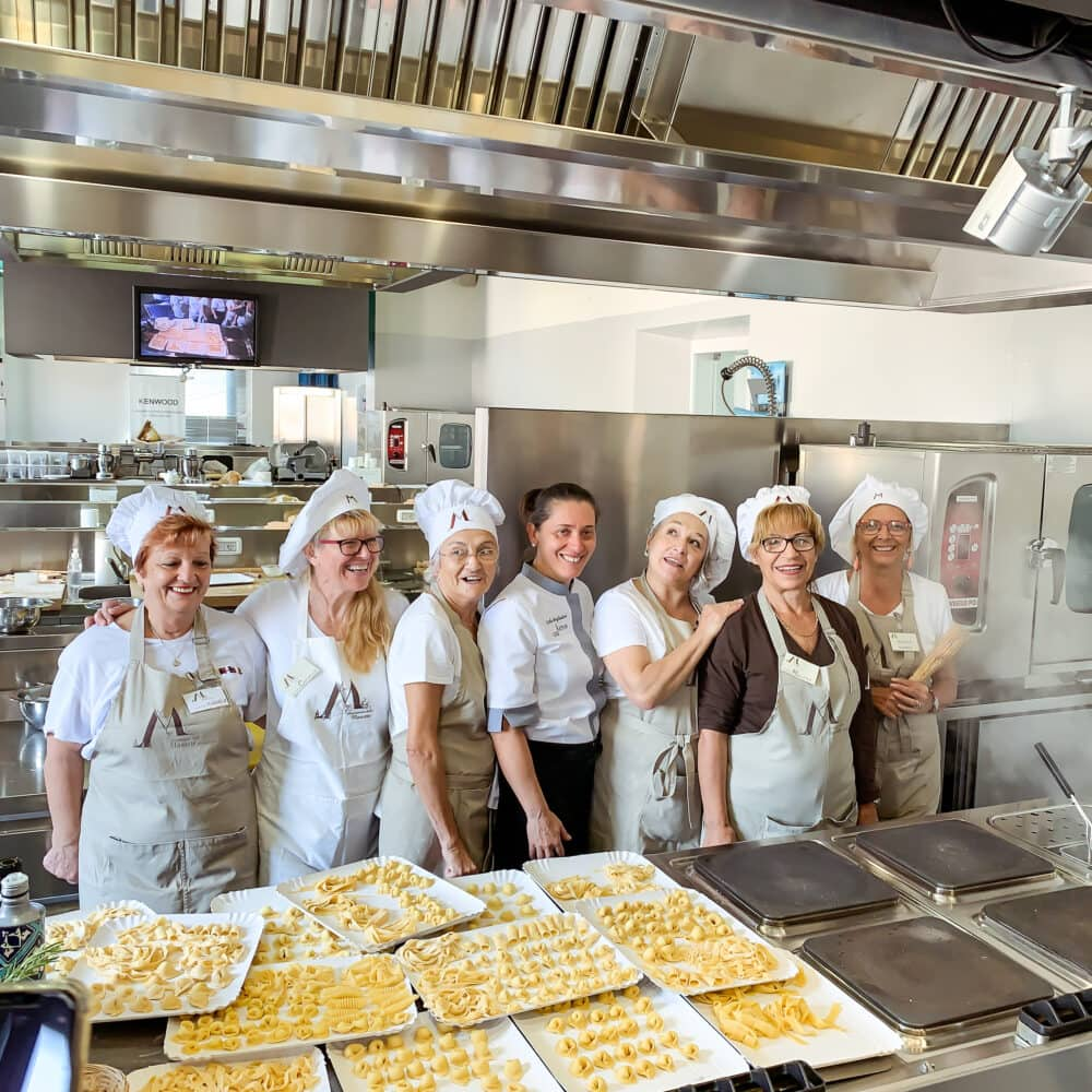 """The """"mariettes"""" (aka instructors) all lined up for an end-of-class photo at Casa Artusi Cooking School."""