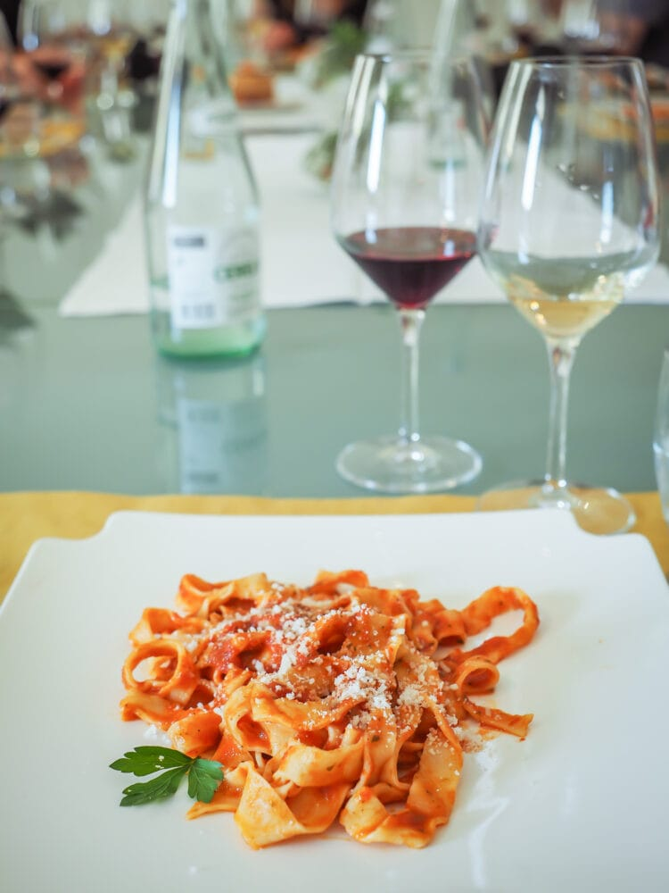 Lunch served at the end of class: handmade pasta with sauce and a glass of local wine.