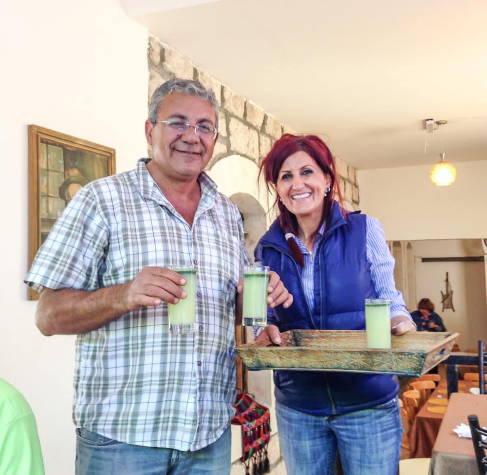 Owners or Hikayet Sitti restaurant in Madaba, Jordan, welcoming us with mint lemonade.