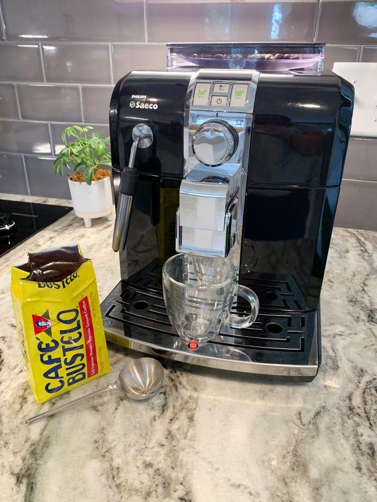 Saeco espresso machine with cafe bustelo ready to brew.