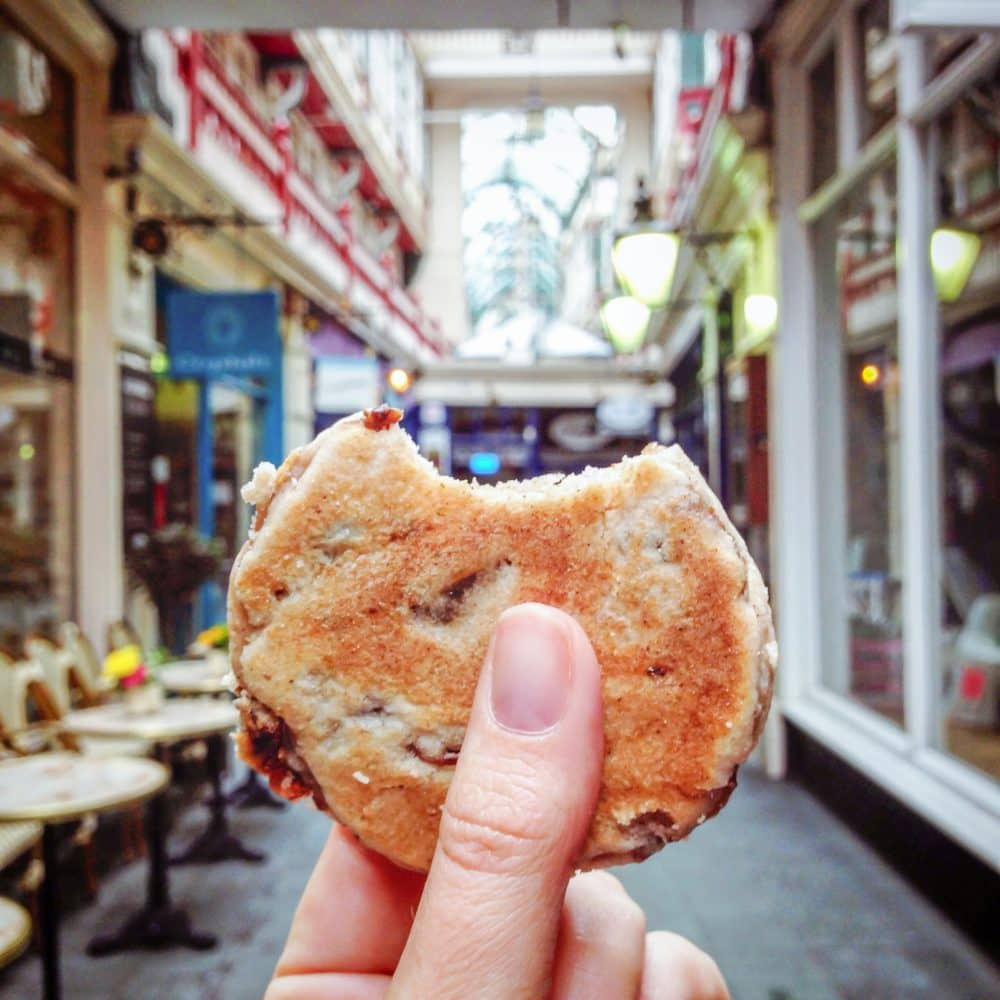Welsh Cake held up in an arcade in Cardiff, Wales.