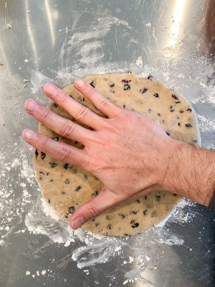Pressing out Welsh Cake dough with hand.