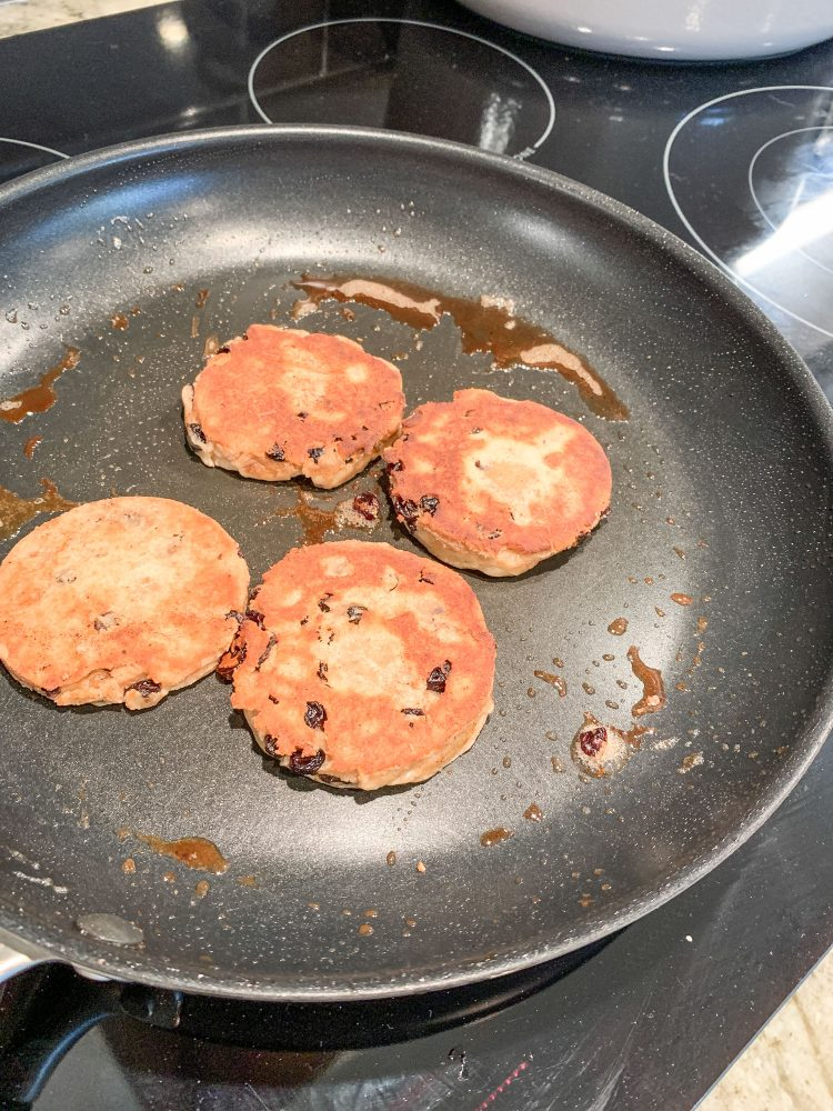 Cooking Welsh cakes in a frying pan with a bit of butter.