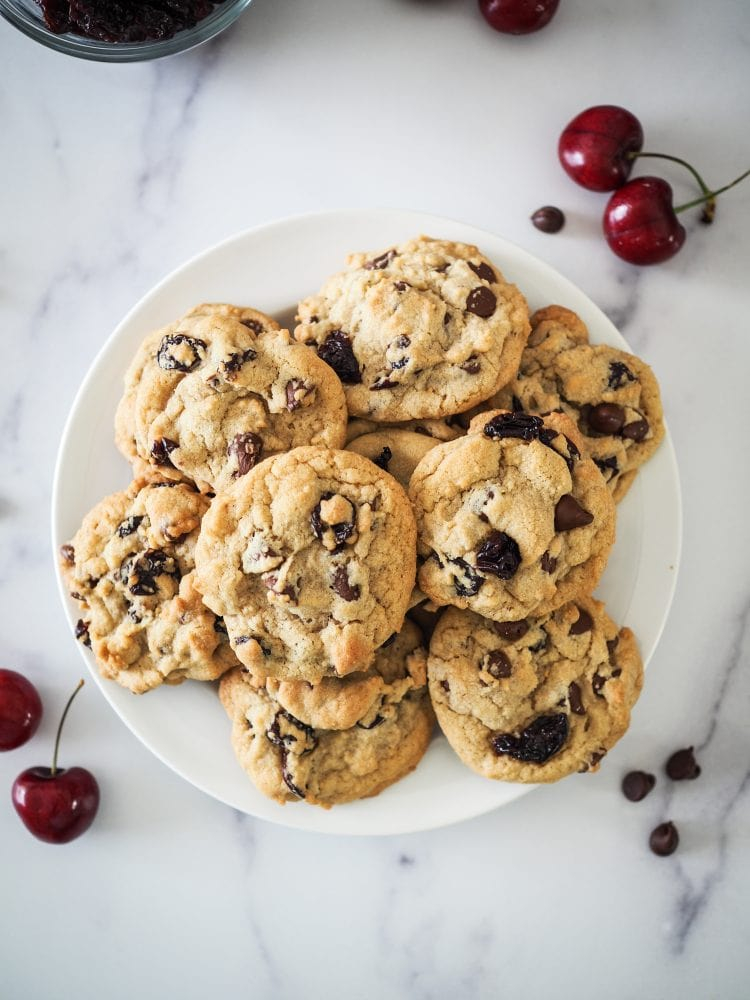 Overhead shot of plate of cherry chocolate chip cookies.